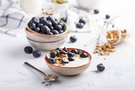 Delicious homemade granola served with yogurt anf blueberries Stock Photo