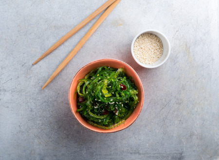 Wakame served with sesame seeds shot from above Stock Photo