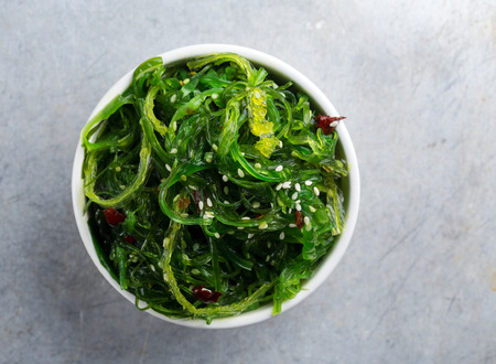 Close up of a bowl with seaweed salad
