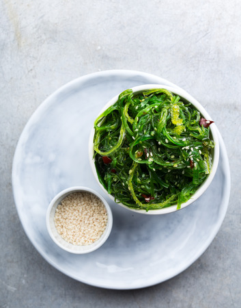 Seaweed chuka salad with sesame seeds shot from above