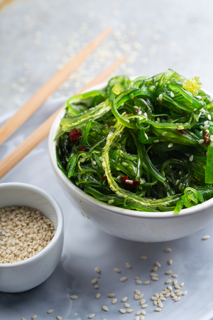 Tasty and nutritious wakame salad with sesam Stock Photo