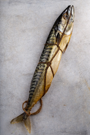 Freshly smoked mackerel tied with rough string