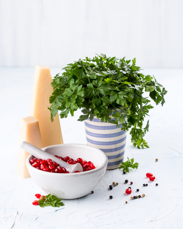 Preparing pomegranate sauce with herbs and cheese Stock Photo