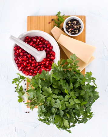 Ingredients for a fresh pomegranate pesto shot from above