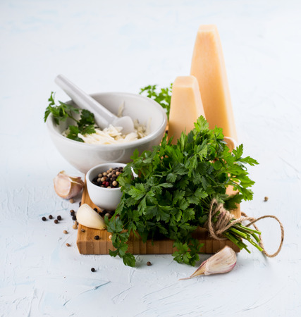 Ingredients for parsley pesto on wooden board