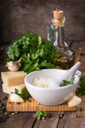 Ingredients for pesto on an old wooden background Stock Photo