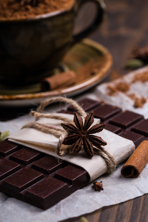 Close up of a star anise on a chocolate bar