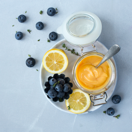 Delicious lemon curd with lemon slices and blueberries