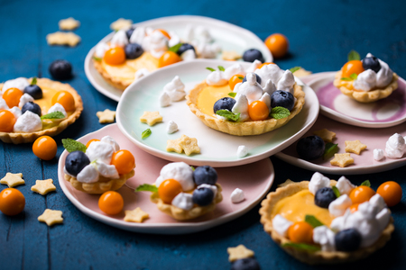 Lemon curd tartlets decorated with italian meringue Stock Photo