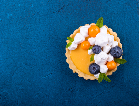 Shot of a lemon curd tartlet, top view, with space for text