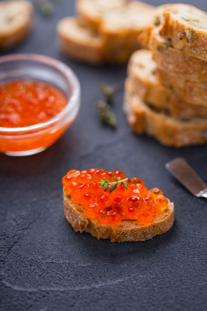 Slice of wheat bread with red caviar on it Stock Photo