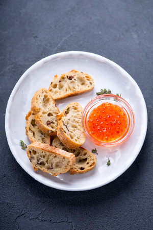 Some cut wheat bread and delicious red caviar