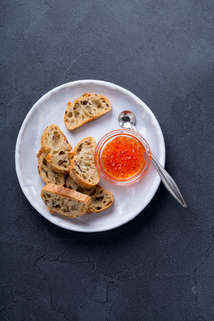 Fresh salted red caviar with slices of bread Stock Photo