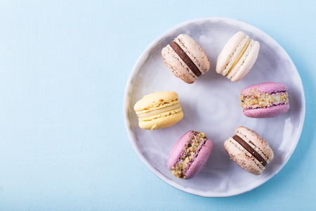 Some tasty macarons on a light blue background