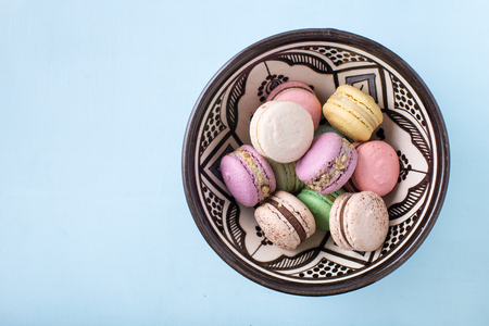 Lots of macarons in a bowl, top view