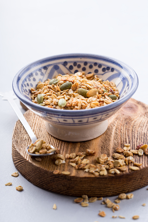 Close up of a small bowl with nutritious homemade granola Stock Photo