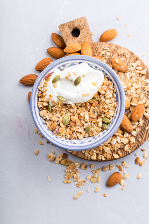 Bowl of oat granola with pepitas and almonds