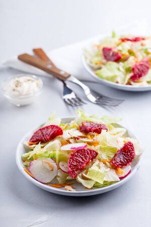 Healthy fresh salad with radished and oranges