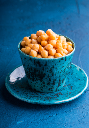 Some boiled ready to eat garbanzo beans in a mug