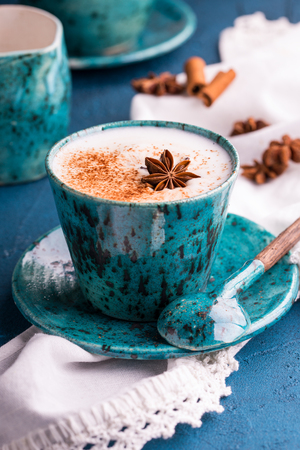 Cup of cappuchino garnished with cinnamon powder and an anise star Stock Photo