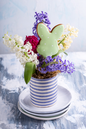 Beautiful hyacinths with a funny bunny cookie between