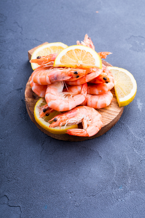 Freshli boiled shrimps with slices of lemon and space for your text