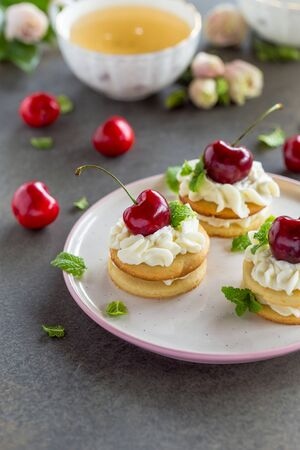 Mini cakes with sweet whipped cream and fresh berries Stok Fotoğraf