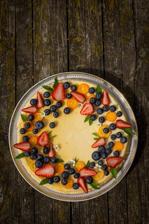 Overhead shot of cheesecake decorated with variety of fresh berries Stok Fotoğraf