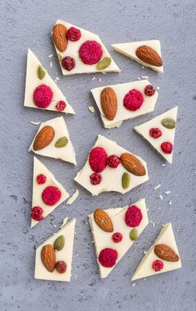 White chocolate with nuts and fruits broken into pieces 스톡 콘텐츠