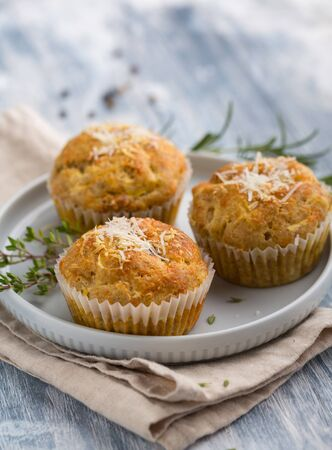 Homemade cheese muffins with herbs