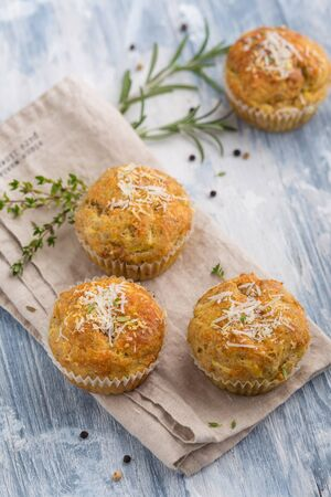 Four homemade muffins with cheese and herbs Stok Fotoğraf