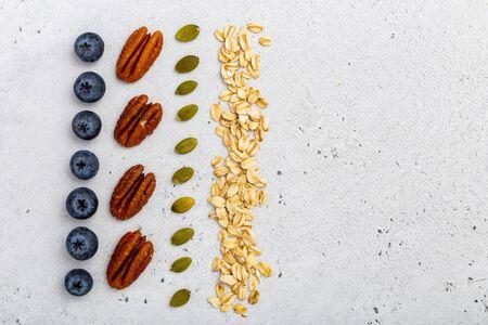 Overhead shot of granola or porridge ingredients Foto de archivo