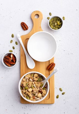 Bowl of granola with pecan nuts and pepitas