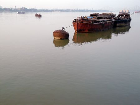 hooghly: Barges tied to a buoy in the Hooghly river in Kolkata (Calcutta) India Stock Photo