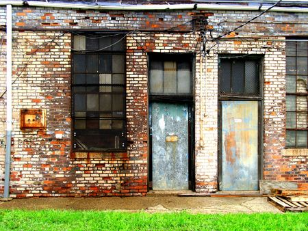 Two doors in the sides of old, run-down buildings