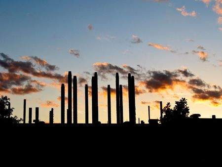 Sunset behind the pipes and columns of an industrial facility Stock Photo - 2651173