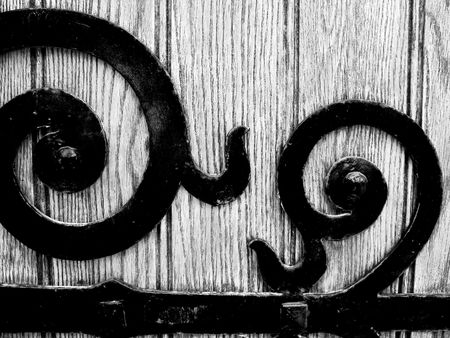 Close up of the wrought iron hinge on an old door