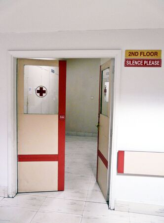 corridors: Doorway in a hospital with a red cross and silence sign