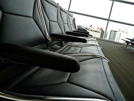 Row of empty chairs at an airport waiting lounge Stock Photo