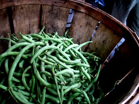 Green beans in an old basket at a farmers market