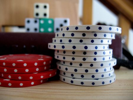 Stacks of poker chips with dice in the background photo