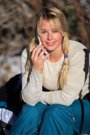 Young woman with blond hair and pigtails on her cellphone photo