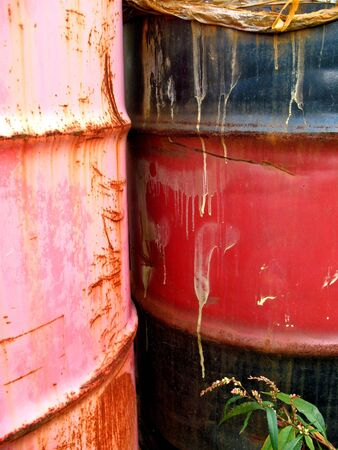 reminding: Old oil drums with streaks reminding you of what they once contained