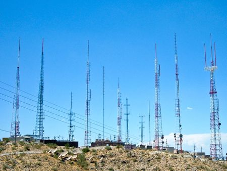 Cell Tower cluster on a desert hilltop photo