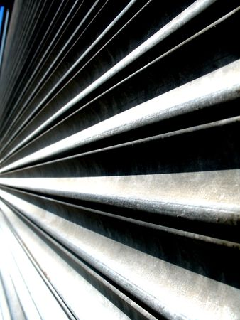 Abstract shot of corrugated metal siding vanishing into the left of the picture Stock Photo