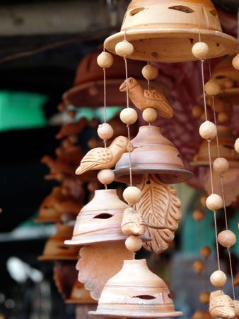 Wind chimes hanging in a stall in the Kalighat Market in Calcutta (kolkata) India photo