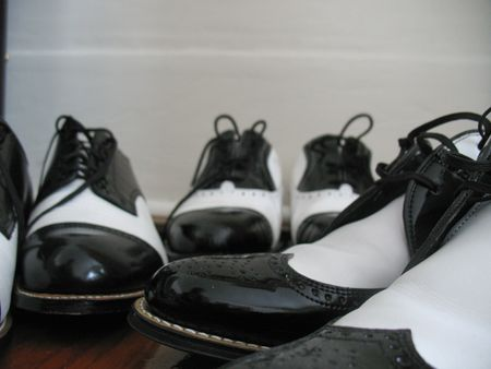 tap dance: Rows of Black and White Dance Shoes Stock Photo
