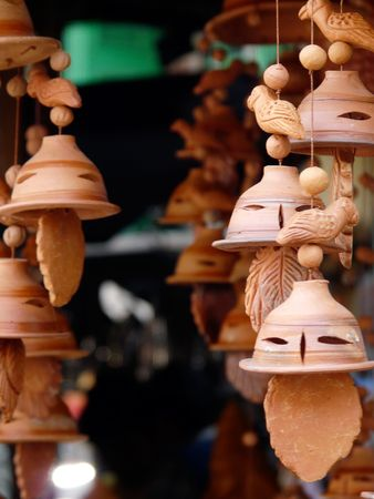 Wind chimes made of terracotta hanging at a stall in the Kalighat market in Calcutta (kolkata) India photo