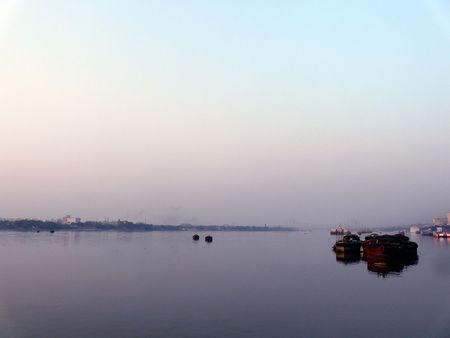 hooghly: Wide angle view of boats moored on a calm Hooghly River in Kolkata (Calcutta) India