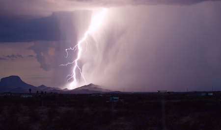Strong lightning bolt striking the ground during a storm lightning up hills Stock Photo - 2650650